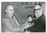 Jack Gindi and Dr. Louis Finkelstein with baby, Dedication of Facilities