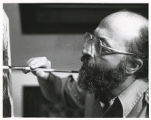 Chaim Potok painting for his art exhibit