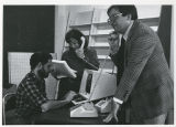 Rick Burke, Rachel Cahn, and Dr. Ron Wolfson testing equipment, Educational Resources Center
