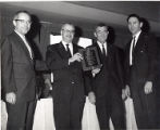 Dr. David Lieber and guests with award plaque