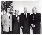 Chief Justice Earl Warren poses with men
