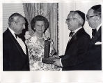 Dr. and Mrs. Abraham Bernstein receiving the Patrons Society of UJ honor.