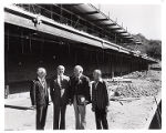 Dr. Lieber, Jack Ostrow, Isadore Familian,and Benjamin Seewack at construction site, Familian...