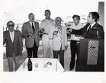 Harold Easton, Cantor Joseph Gole and members of Sinai Temple, making a toast, Dedication Advance...